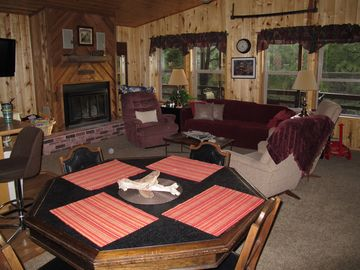 Living area with woodburning fireplace and aspen warm venue