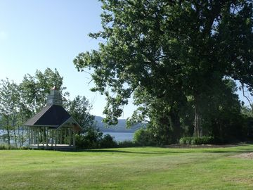 The grand cottonwood offers shade for lots of lawn games and activities.