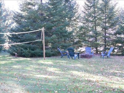 Eagle River cabin rental - Front lawn with firepit and volleyball and badmitton net
