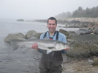 West Yarmouth cottage photo - It's not called FishTales for nothing.... (the striped bass was released)
