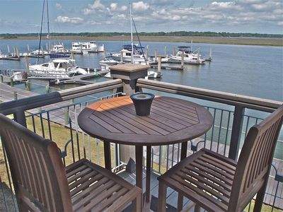 Deck View - Have coffee or a cold beverage at the pub table and watch the boaters head out! Dolphins are often spotted here too.