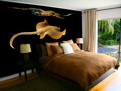 The Sting Ray Room features a king size platform bed with 1200 count sheets and duvet, feather bed topper and down comforter. Flat screen TV with Direct TV premium package.