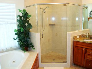 Clearwater Beach townhome photo - Master Bathroom- Jetted Garden Tub, walk-in shower & double sinks