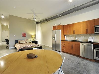 Open Loft Design with Designer Appliances, Open Ducts, 11 Foot Ceilings, Granite
