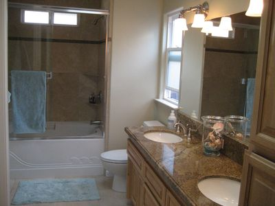 Master bath with whirlpool tub.