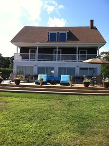 Front of Home with beautiful new deck and relaxing lounge chairs.