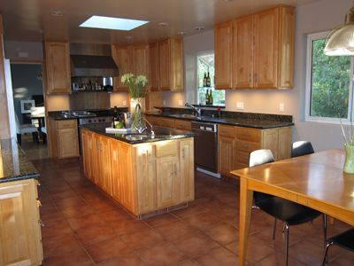 Eat-In Kitchen with Granite Counters, Sub Zero Refrigerator and Wolf Range