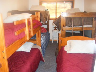 Bunk room with 7 twin beds