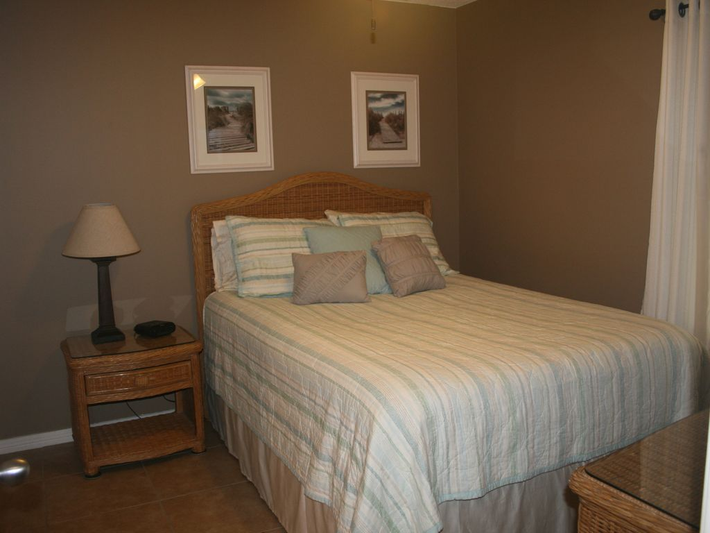Queen size bed with ceiling fan in bedroom