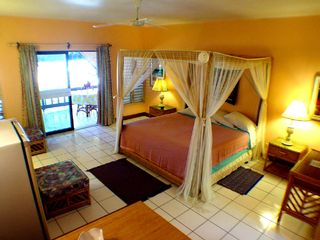 Negril cottage photo - bamboo king bed in Veranda suites
