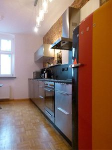 LB2: stainless steel kitchen, exposed brick wall