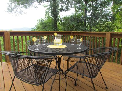 1 of 2 outdoor patio dining tables . . .