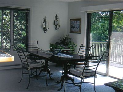 Dining Room (seats 6 - 8) overlooking deck and courtyard
