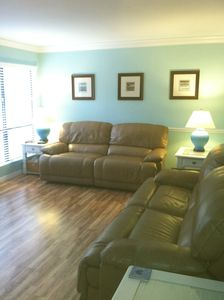 4 electronic recliners in Great Room.