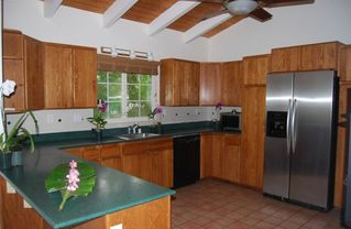 Poipu house photo - Built by a restaurant owner, this kitchen has every convenience. BBQ on patio