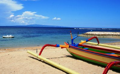 Sanur's white sand beach via a private entrance