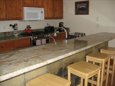 Kitchen is easy to work in, granite counters, Bosch gas stove, all upgraded.