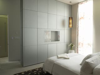 San Francisco estate photo - Master bedroom with silver glass wall cabinetry