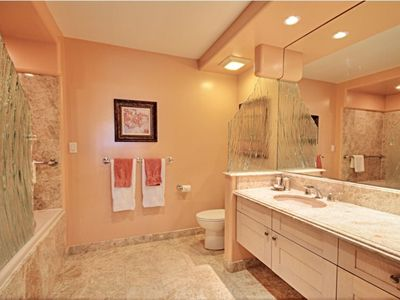 Master bathroom features soaker tub & rainfall shower.