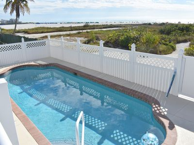 beachfront home with heated pool just steps to the Gulf waters