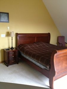 King bed in 3rd floor Suite with Deck balcony and vaulted ceilings.