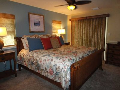 Handsome Tommy Bahama furniture with a king bed in the master suite