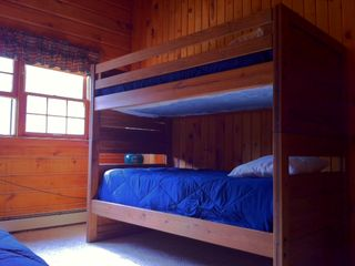 Jackson house photo - Bunk room with TV (DVD VHS only) Three single beds
