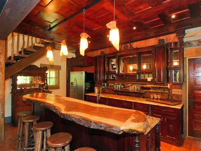 Gorgeous old west saloon kitchen. Solid custom walnut bar, rawhide lighting