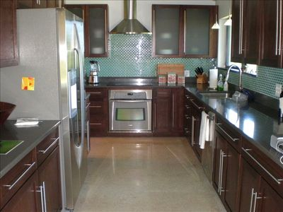 all new kitchen w/ wood cabinets and granite tops w/ stainless appliances