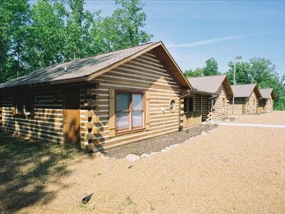 Deer Cabins with a double kitchen, dining area, 8 bedrooms, and 4.5 bathrooms.