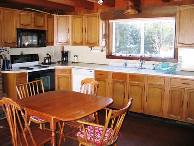 The Sow's Ear of Bethlehem NH - This fully equipped kitchen even includes great views of Garnet Hill from the window by the sink, and views to Lafayette from the table.