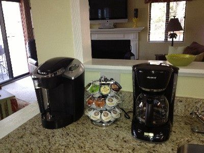 Keurig with starter K-cups and regular coffee maker at the wet bar