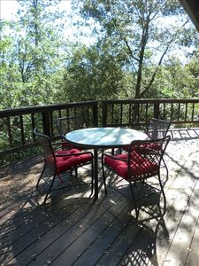 The deck has a beautiful view. A  barbecue is available for family picnics.