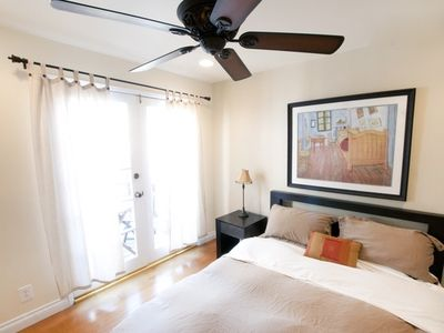 Bedroom includes ceiling fan and french doors that open to the outdoor deck.