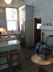 Northport cottage photo - Kitchen Detail with second bath in the background.