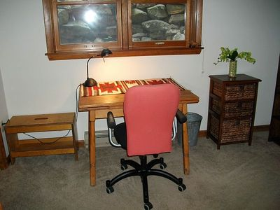 Basement bedroom writing desk area.