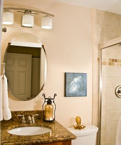 Junior Master bathroom, sink, walk in tiled shower.
