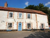 A delightful 300-year-old cottage with bags of character and within easy wallking distance of the beach