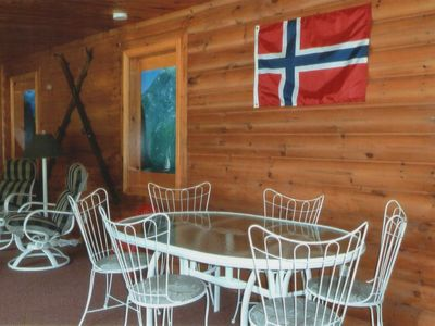 Willmar cabin rental - Three-season porch offers dining for six plus a toddler picnic table for four.