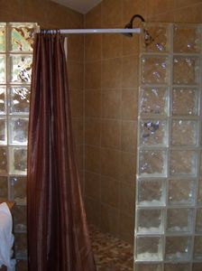 This shower features river rock flooring.