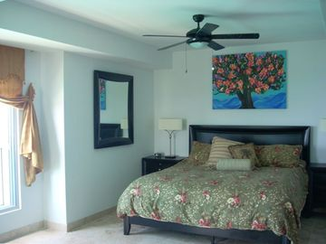 Oversized Master Bedroom with King Bed and Caribbean view