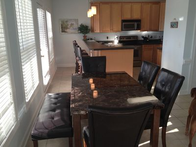 Dining Room with seating for 6, plus 4 barstools at the kitchen counter.