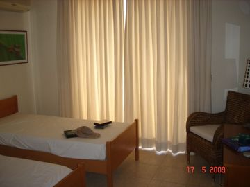Bedroom 2 with twin beds, patio door to Balcony
