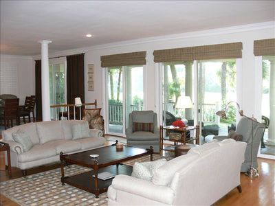 Comfortable living area opens to deck areas & overlooks great golf/lagoon views