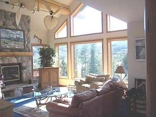 Big Sky house photo - Great room w overstuffed chairs & Lone Peak framed