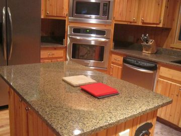 Kitchen features Professional Grade Appliances and large work island.