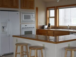 Bandon house photo - Kitchen with gas stove, electric oven and microwave