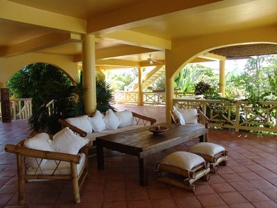 Loggia around the pool with BBQ area, sofas, hammocks and 2 outisde tables