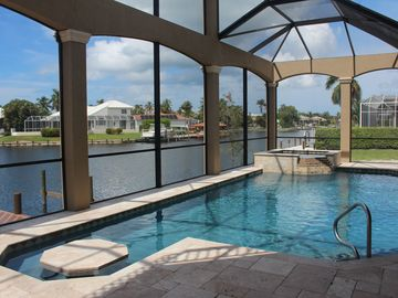 Vacation Homes in Marco Island house rental - Yes, you can sit at a table in the pool or enjoy the jacuzzi - private resort!