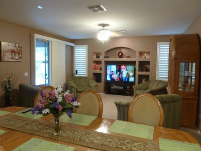Family room entertainment center with brand new 60 inch LED TV.